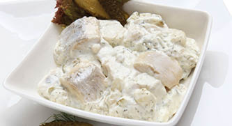 Herring bites in dill sauce